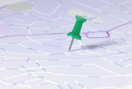 detail of a green map pin in english street map