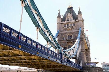 Photo pour Tower Bridge in London with bridge lowered and blue sky - image libre de droit