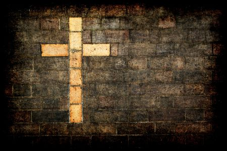 grungy cross of christ built into a brick wall as background