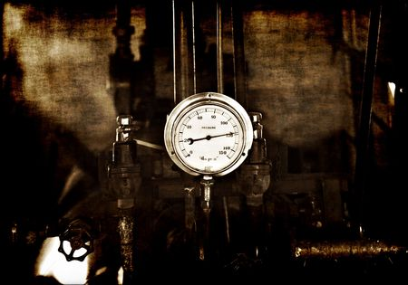 gritty and grungy image of machinery under pressure gauge lets out steam