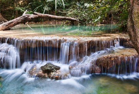 beautiful waterfall cascades in erawan kanachanburi thailand