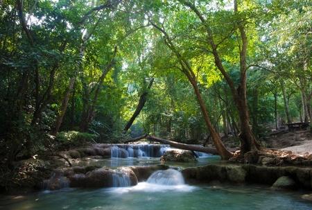 Foto de beautiful waterfall cascades in erawan kanachanburi thailand - Imagen libre de derechos