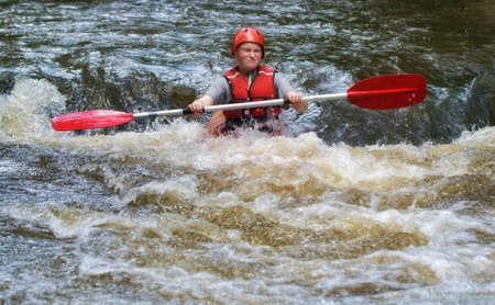 teenager white water kayaking