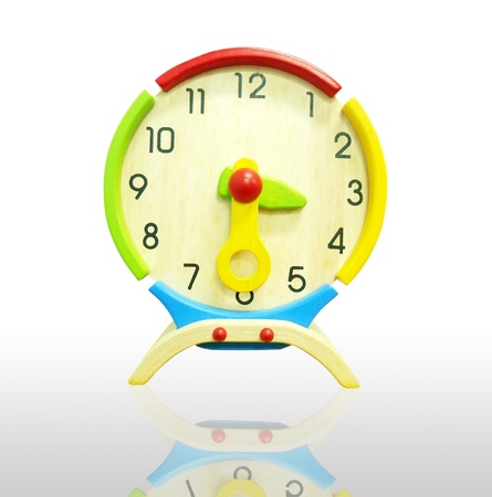 Colorful wooden clock isolated on a white background