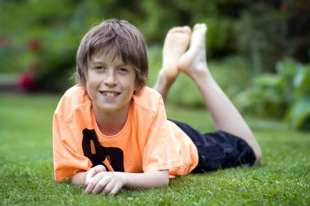 Boy relaxing on the lawn