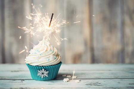 Photo pour Christmas cupcake decorated with sparkler - image libre de droit