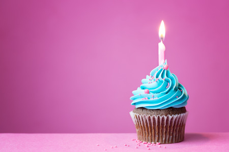 Photo for Birthday cupcake with a single candle - Royalty Free Image
