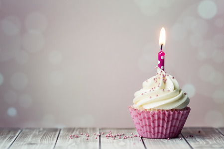 Photo for Pink birthday cupcake with candle - Royalty Free Image