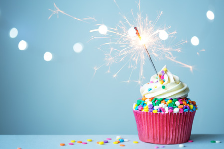 Photo for Colorful cupcake with sparkler - Royalty Free Image