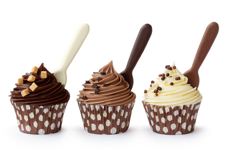 Photo pour Cupcakes decorated with white, milk and dark chocolate frosting - image libre de droit