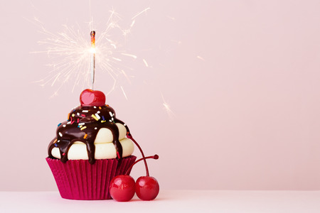 Photo for Ice cream sundae cupcake with sparkler - Royalty Free Image