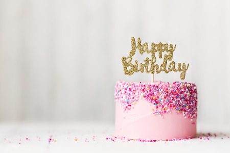 Photo for Birthday cake with sparkly banner - Royalty Free Image