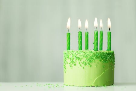 Photo for Green birthday cake with green candles - Royalty Free Image