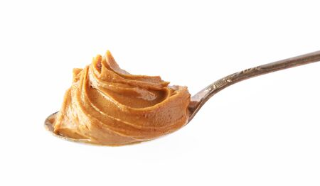 Photo pour spoon of peanut butter isolated on white background - image libre de droit