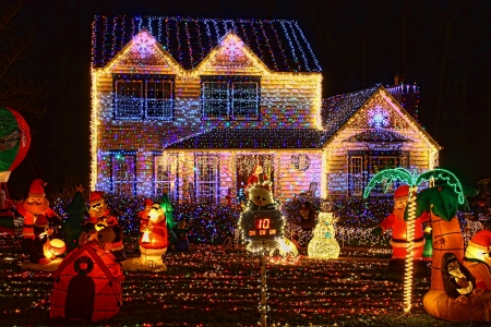 A Home decorated and lighted with 650,000 lights and over 60 inflatables for Christmas and for New Year Eve at Night in Virginia