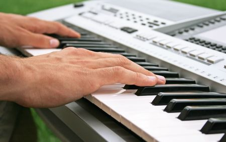 Musician playing on keyboard.