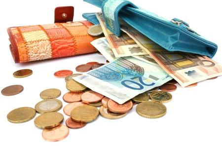Foto de Money in wallets isolated on white background. - Imagen libre de derechos