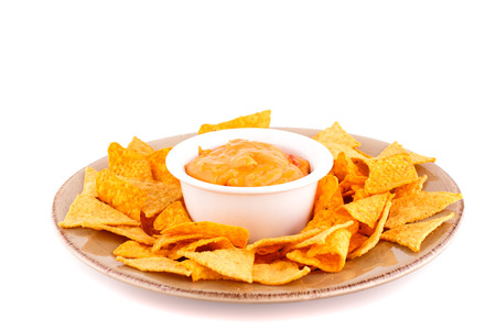 Nachos and cheese sauce isolated on white background.