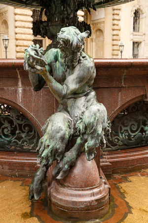 Foto de The figurine at the statue of Hygieia the goddess of health and hygiene n the courtyard of Hamburg City Hall (Rathaus), Germany. - Imagen libre de derechos