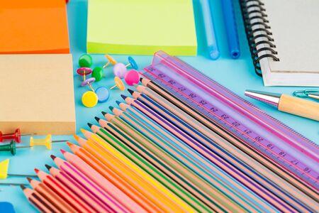 Photo pour Back to school, stationary on blue background. - image libre de droit