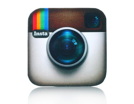 KIEV, UKRAINE - FEBRUARY 05, 2015:Instagram logotype camera printed on paper and placed on white background. Instagram is an online mobile photo-sharing, video-sharing and social networking service.