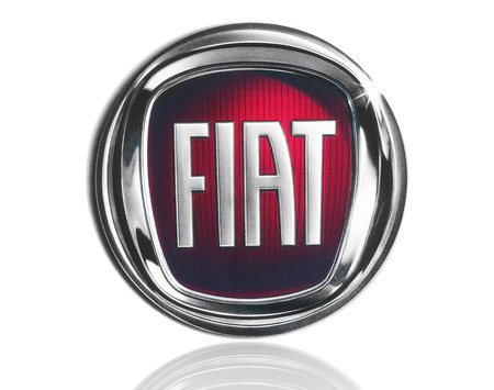 KIEV, UKRAINE - MARCH 21, 2015: Fiat logo printed on paper and placed on white background. Fiat Chrysler Automobiles is a is a multinational company and the world's seventh-largest auto maker.