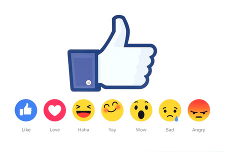 Photo pour Kiev, Ukraine - February 26, 2016: New Facebook like button 6 Empathetic Emoji Reactions printed on white paper. Facebook is a well-known social networking service. - image libre de droit