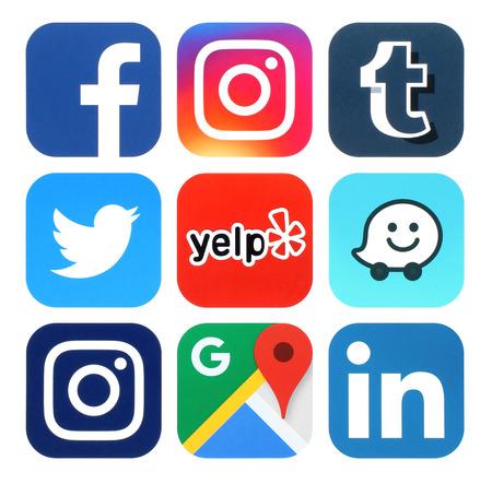 Foto de Kiev, Ukraine - July 25, 2016: Collection of popular social media, travel and navigation logos printed on paper:Facebook, Twitter, Instagram, Yelp, Google Maps, Waze, Tumblr and Linkedin - Imagen libre de derechos