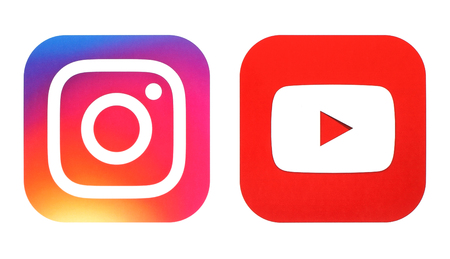 Kiev, Ukraine- July 25, 2016: Instagram new logo and Youtube icon printed on white paper