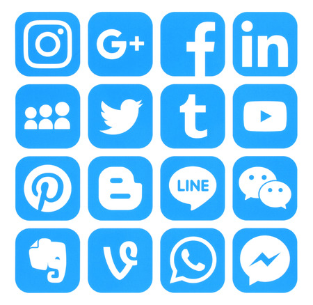 Foto de Kiev, Ukraine - September 06, 2016: Collection of popular blue social media icons printed on paper:Facebook, Twitter, Google Plus, Instagram, Pinterest, LinkedIn, Blogger, Tumblr and others - Imagen libre de derechos