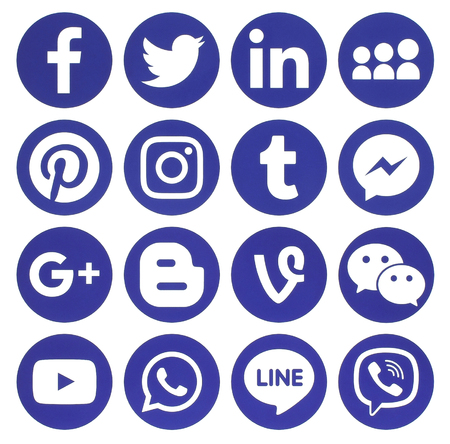 Photo for Kiev, Ukraine - February 13, 2017: Collection of popular blue round social media icons, printed on paper: Facebook, Twitter, Google Plus, Instagram, Pinterest, LinkedIn, Blogger, Tumblr and others - Royalty Free Image