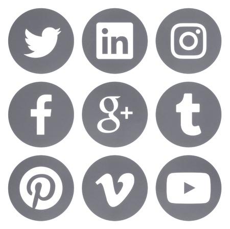 Foto de Kiev, Ukraine - Febraury 28, 2017: Collection of round popular social media gray logos printed on paper: Facebook, Twitter, Google Plus, Instagram, Pinterest, LinkedIn, Vimeo, Tumblr and Youtube - Imagen libre de derechos