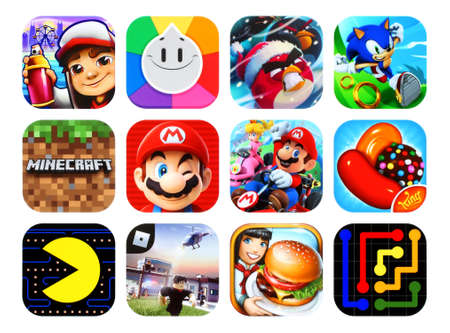 Photo for Kiev, Ukraine - February 23, 2020: Icons collection of the popular mobile video games, such as: Subway Surfers, Trivia Crack, Angry Birds, Sonic Dash, Super Mario Run, and others - Royalty Free Image