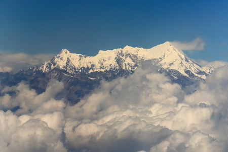Aerial view of the snowcapped Himalayas mountain range with Imja Tse-Island Peak at 6189 ms.seen from plane on flight Kathmandu-Lhasa. Nepal-Tibet A.R.-China.