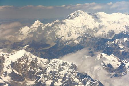 Aerial view of the snowcapped Himalayas mountain range with Cho Oyu at 8201 ms.+Ngozumpa Kang peaks I-II-III at 7916-7743-7681 ms.seen from plane on flight Kathmandu-Lhasa. Nepal-Tibet A.R.-China.
