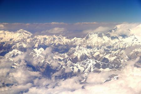 Himalayas airview. Peaks -L.ro R.- Ngozumpa Kang I-II 7743-7681 ms.+Gyachung Kang 7952ms.+Pumo Ri 7000 ms.+Nuptse 7861 ms.+Sagarmatha-Eveest 8844 ms.+Lhotse 8516 ms.from plane on flight Kathmandu-Lhasa. Nepal-Tibet A.R.-China.