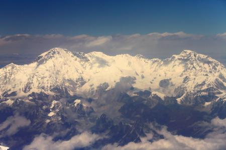 Aerial view of the snowcapped Himalayas mountain range with Cho Oyu 8201 ms.+Ngozumpa Kang peaks I-II-III 7916-7743-7681 ms.+Gyachung Kang 7952 ms.seen from plane on flight Kathmandu-Lhasa. Nepal-Tibet A.R.-China.
