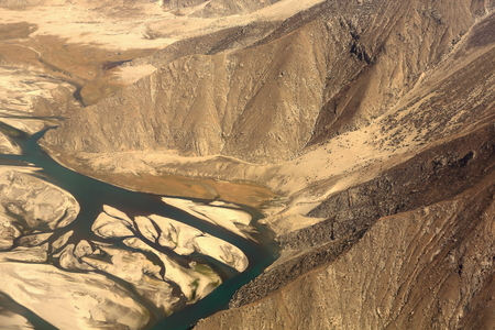 The Yarlung tsangpo-river flowing through the tibetan plateau near Lhasa city-view from plane on flight Kathmandu-Nepal to Lhasa-Tibet. China.
