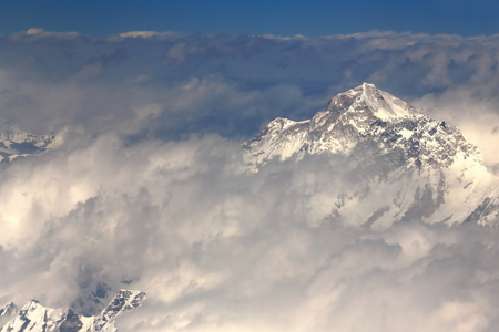 Aerial view of the snowcapped Himalayas mountain range with several peaks over 7000 ms.high seen from plane on flight Kathmandu-Lhasa. Nepal-Tibet A.R.-China.