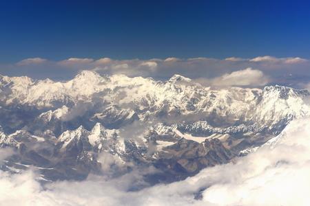 Himalayas airview. Peaks -L.to R.- Cho Oyu 8201 ms.+Ngozumpa Kang I-II 7916-7743-7681 ms.+Gyachung Kang 7952 ms.+Nuptse 7861 ms.from plane on flight Kathmandu-Lhasa. Nepal-Tibet A.R.-China.