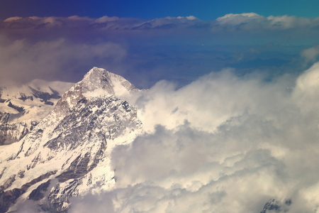 Air view of the snowcapped Himalayas mountain range with several peaks over 7000 ms.high seen from plane on flight Kathmandu-Lhasa. Nepal-Tibet A.R.-China.