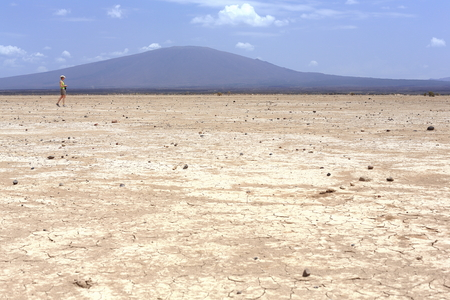 Dry barren land of the Danakil desert-all tracks erased on the way from Afrera town to Dodon-basecamp to the Erta Ale volcano. View to the S.of Hayli Gubbi volcano at 521 ms. Afar region-Ethiopia.