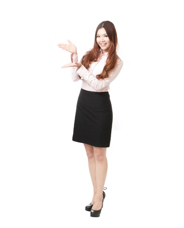 Full length of pretty business woman giving presentation isolated on white background, model is a asian female