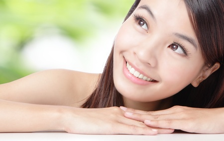 Photo for Close up of beautiful asian woman face with green background - Royalty Free Image