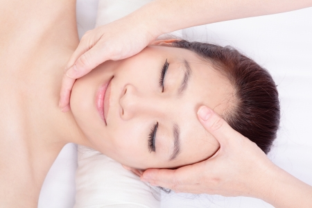 Beautiful asian woman enjoy receiving face and head massage at spa center, view from high angle