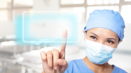 successful Young woman surgeon doctor making use of innovative technologies, she press touchscreen with empty button copy space, asian model