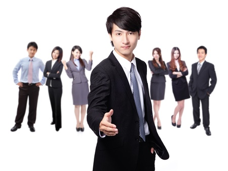 Handsome young business man happy smile shake hand over group of business people background