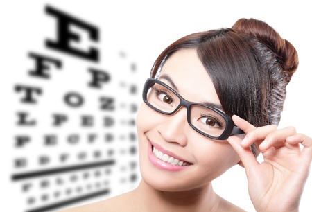 Photo pour beautiful woman with glasses on the background of eye test chart, eye care concept, asian beauty - image libre de droit