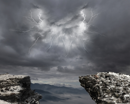 danger precipice on the mountain with rainstorm clouds and lightning