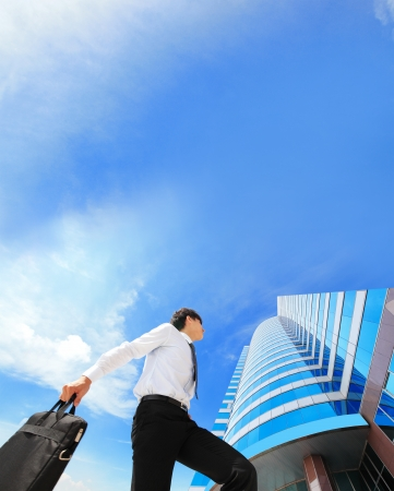 happy successful business man outdoors Next to Office Buildings with cityscape and sky in the background, asian people